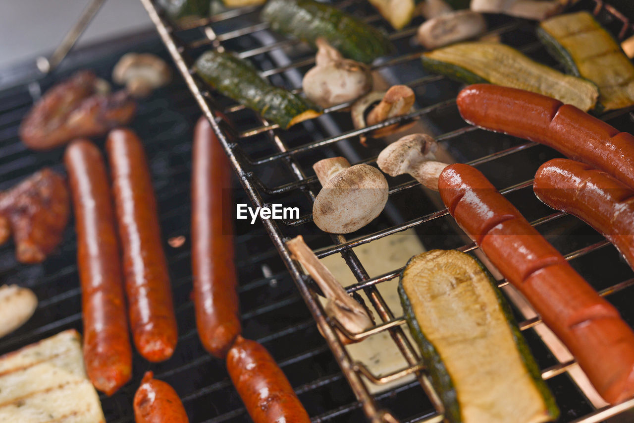 High Angle View Of Food Cooking On Barbecue Grill