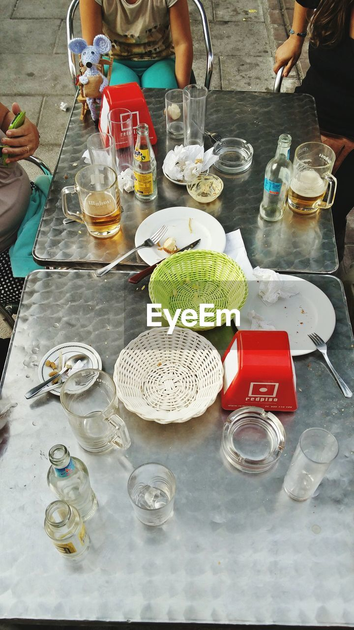table, drinking glass, food and drink, real people, drink, plate, healthy eating, refreshment, bowl, food, high angle view, jar, day, two people, men, human hand, place setting, eating, togetherness, indoors, freshness, human body part, ready-to-eat, people