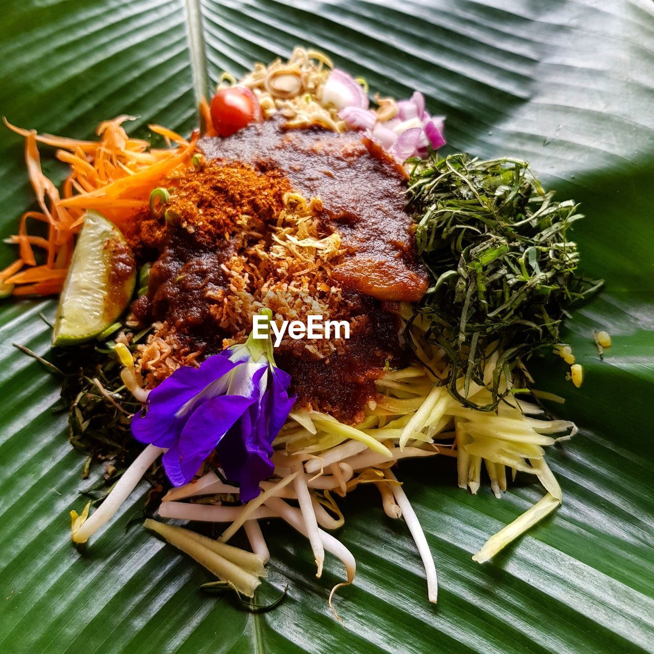 freshness, ready-to-eat, food, food and drink, plate, meat, close-up, indoors, no people, table, plant, healthy eating, still life, serving size, vegetable, leaf, high angle view, meal, banana leaf, flowering plant, leaves, herb