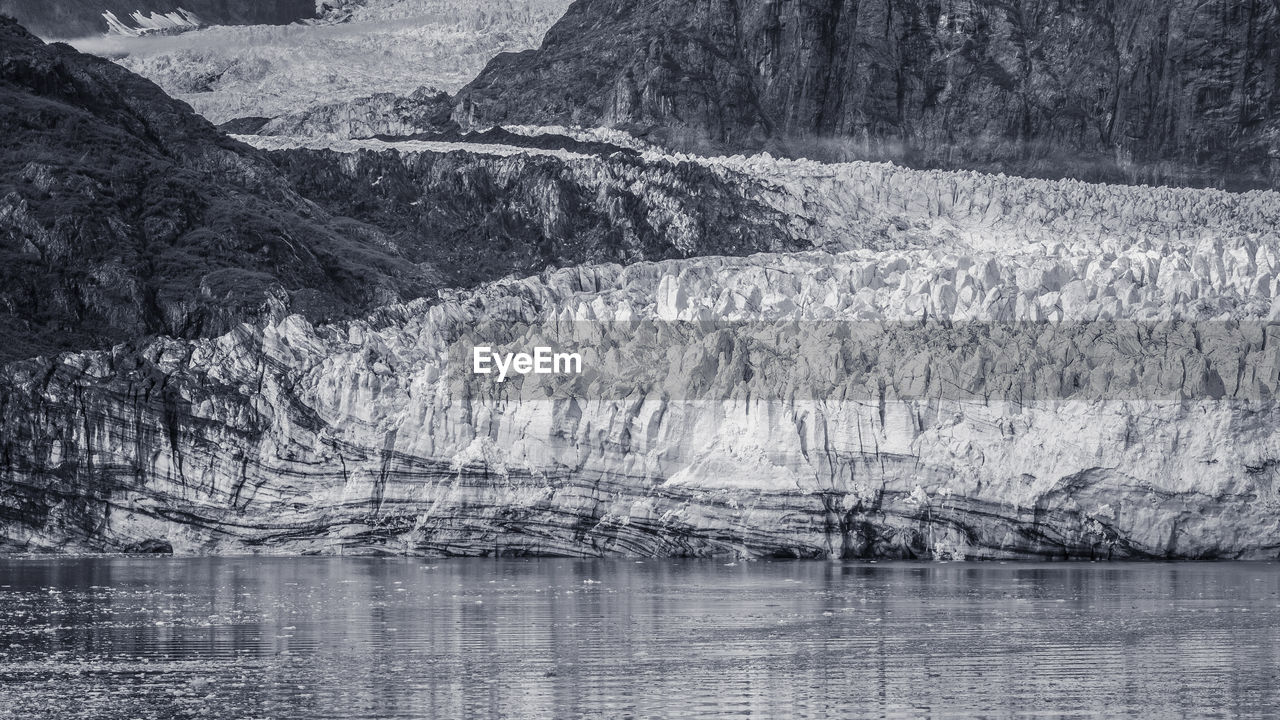 mountain, water, scenics - nature, beauty in nature, environment, lake, nature, day, no people, tranquil scene, tranquility, non-urban scene, landscape, waterfront, tree, outdoors, remote, land, travel destinations, formation, eroded