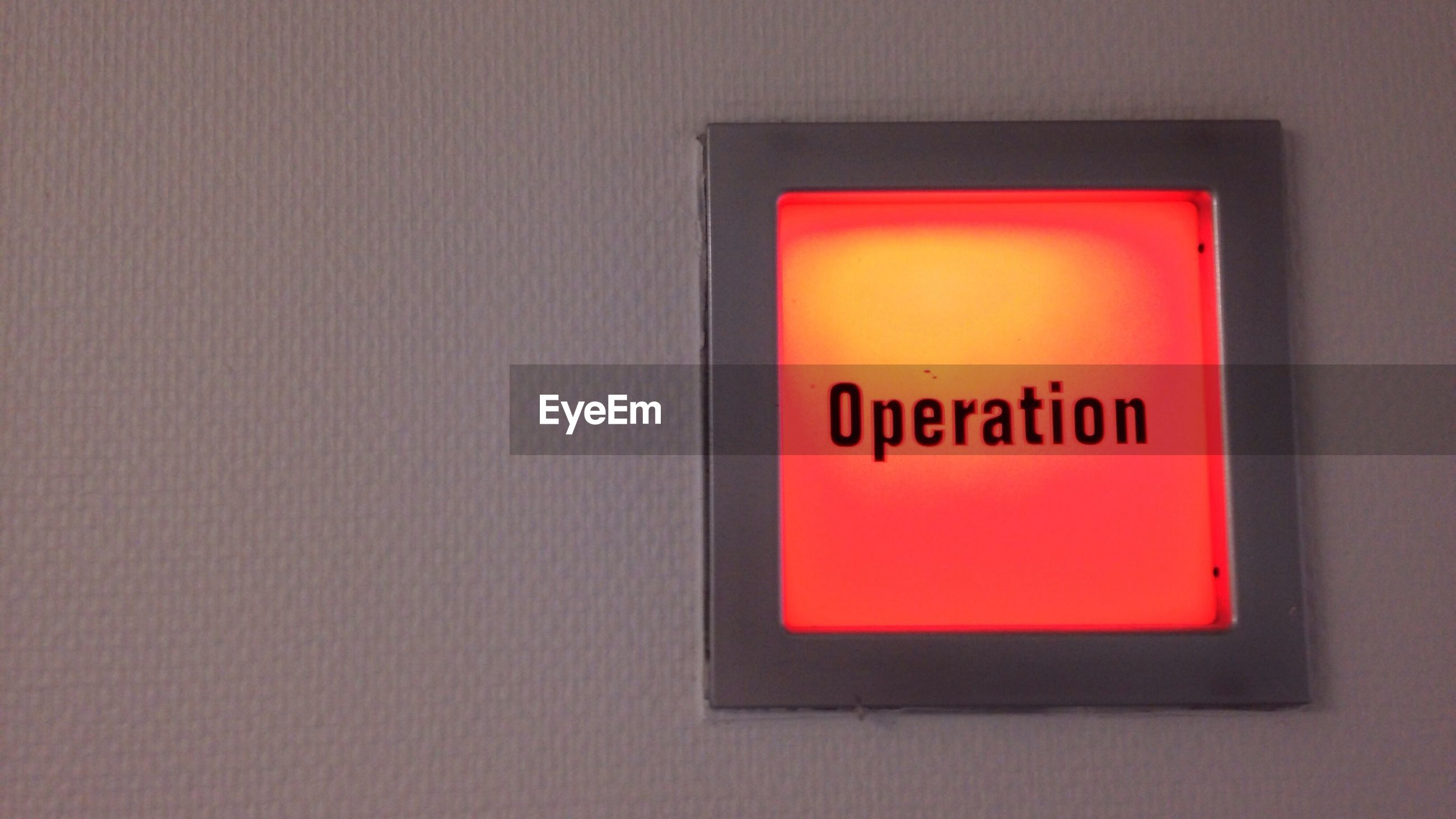 Low angle view of illuminated operation sign