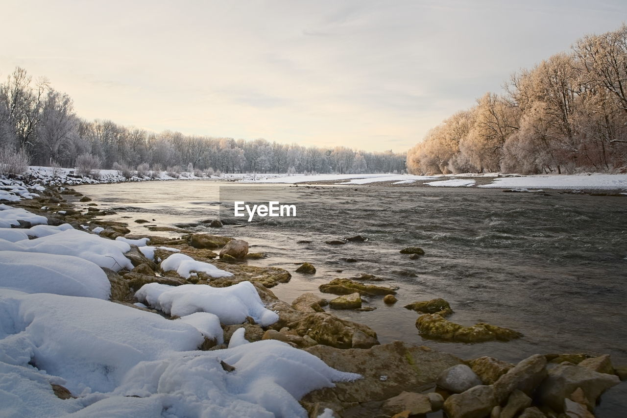 cold temperature, winter, water, snow, beauty in nature, tree, scenics - nature, nature, sky, plant, tranquility, tranquil scene, no people, frozen, day, cloud - sky, non-urban scene, land, ice, flowing water
