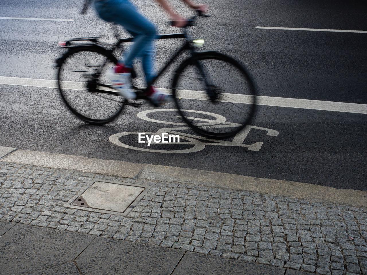 Bicycle Driving On Bicycle Lane On Street