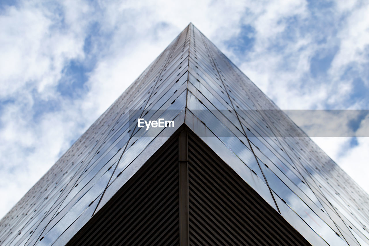 architecture, building exterior, low angle view, sky, built structure, cloud - sky, building, day, nature, modern, no people, tall - high, city, office building exterior, outdoors, office, skyscraper, corner, directly below, pattern