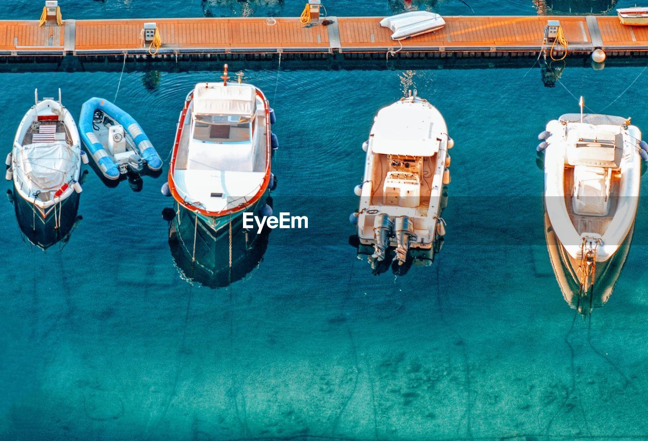 water, nautical vessel, mode of transportation, transportation, sea, day, high angle view, nature, moored, no people, waterfront, rope, outdoors, blue, travel, sunlight, ship, deck, luxury, passenger craft, sailboat