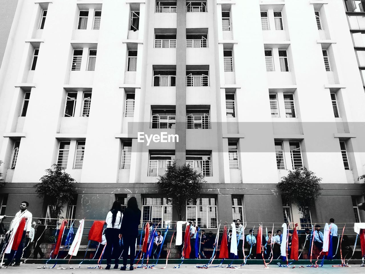 building exterior, real people, built structure, architecture, patriotism, men, large group of people, uniform, parade, flag, pride, day, marching, city, military uniform, outdoors, unity, military parade, togetherness, tree, politics and government, adult, people