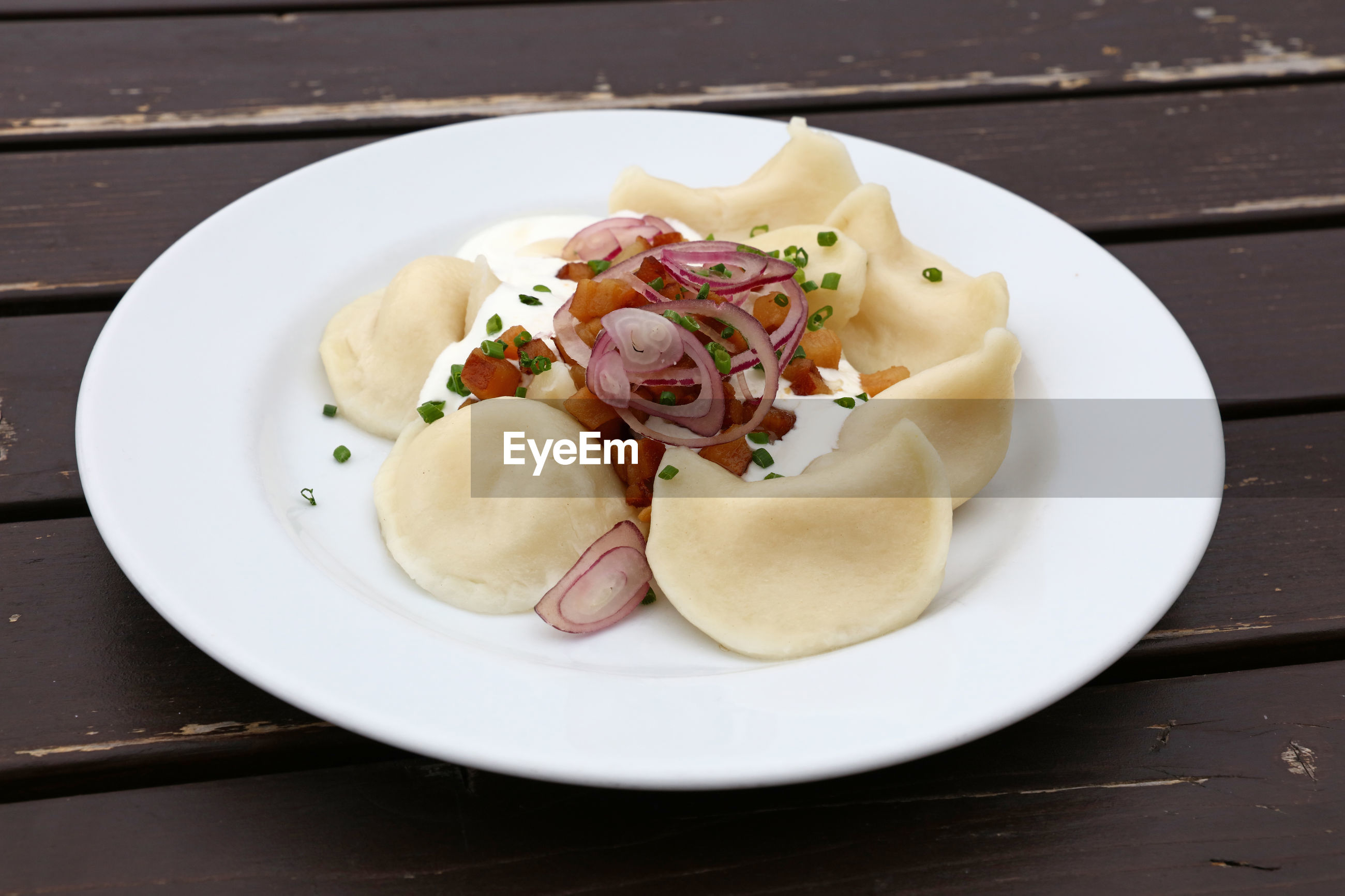 High angle view of pierogi served in plate on table