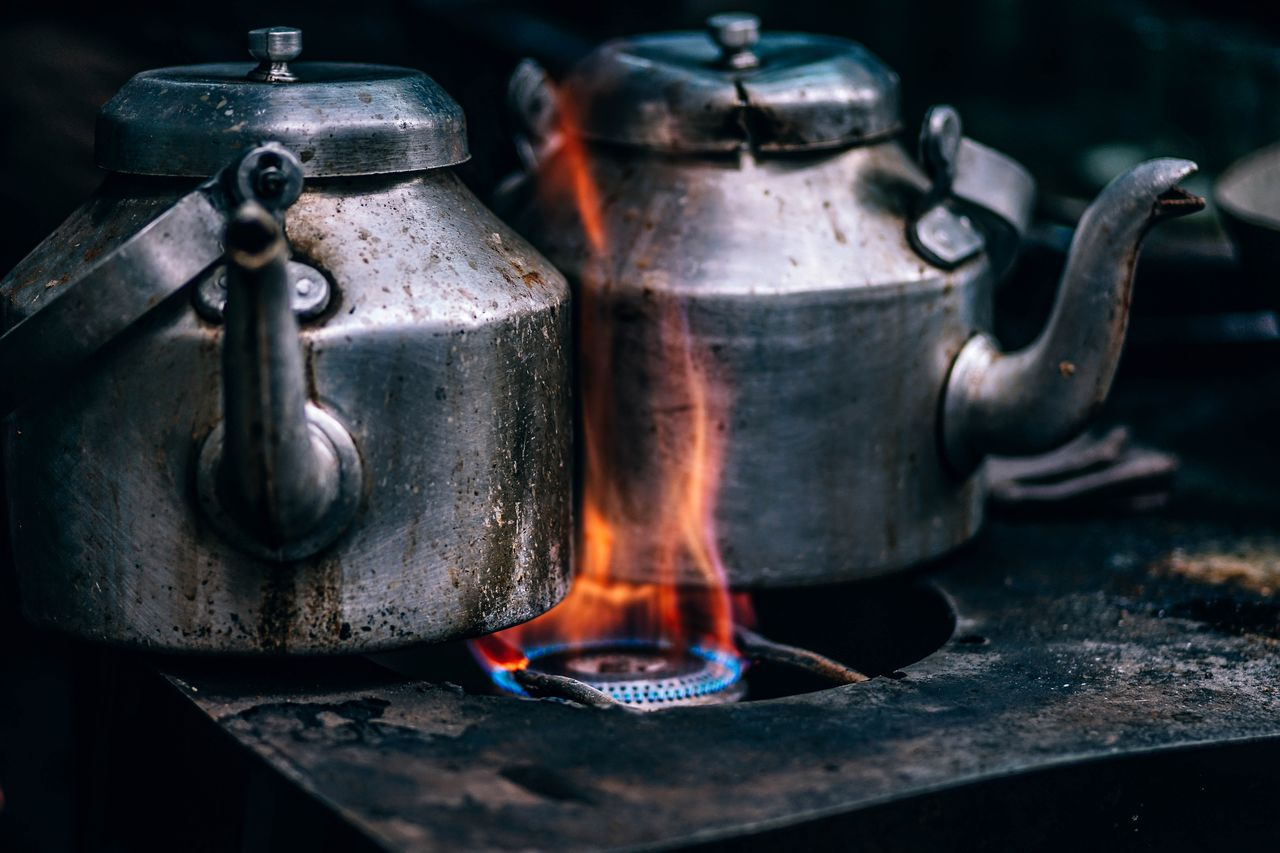 Close-Up Of Kettles On Stove