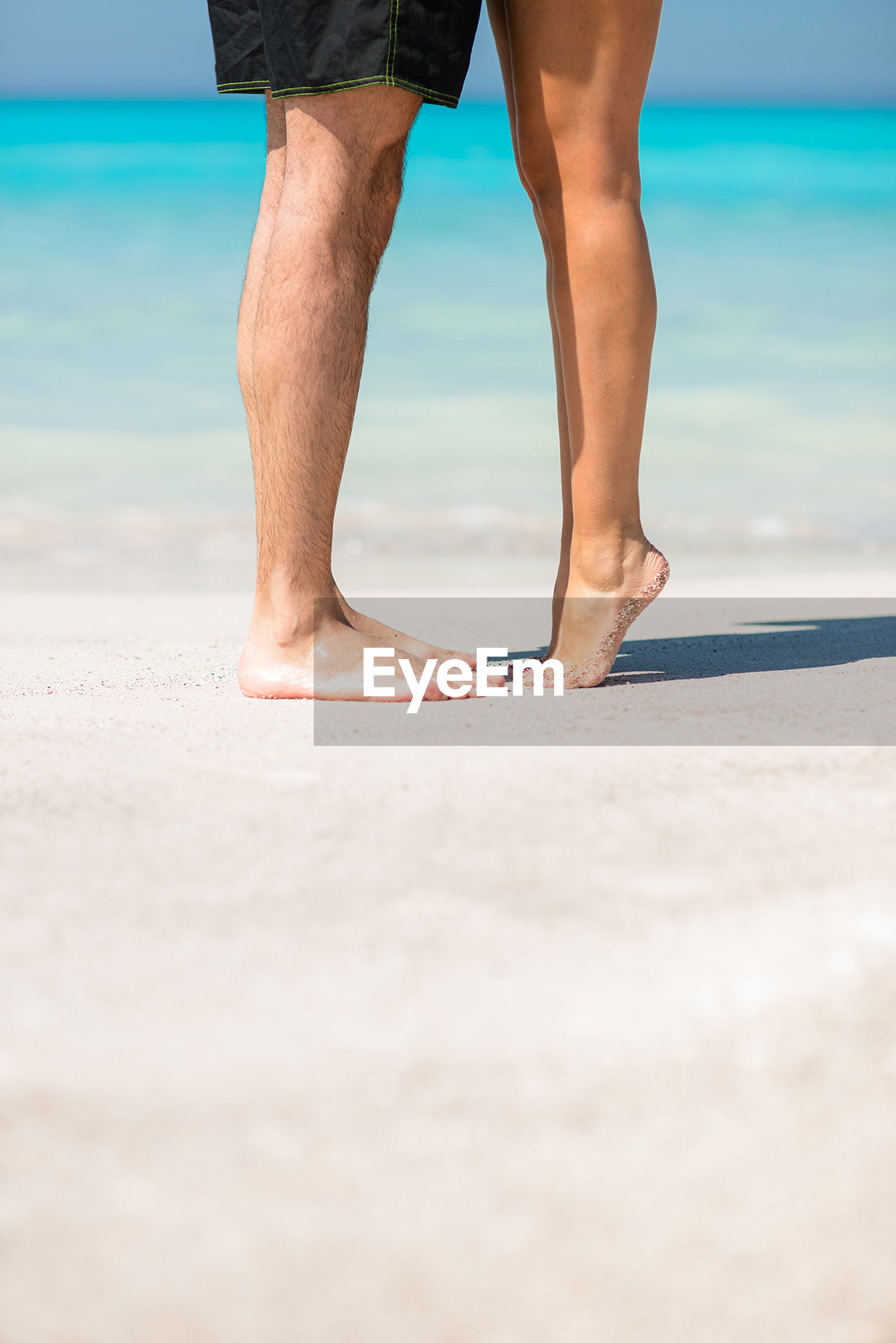 low section, person, sea, beach, lifestyles, human foot, standing, barefoot, leisure activity, horizon over water, water, shore, sand, vacations, men