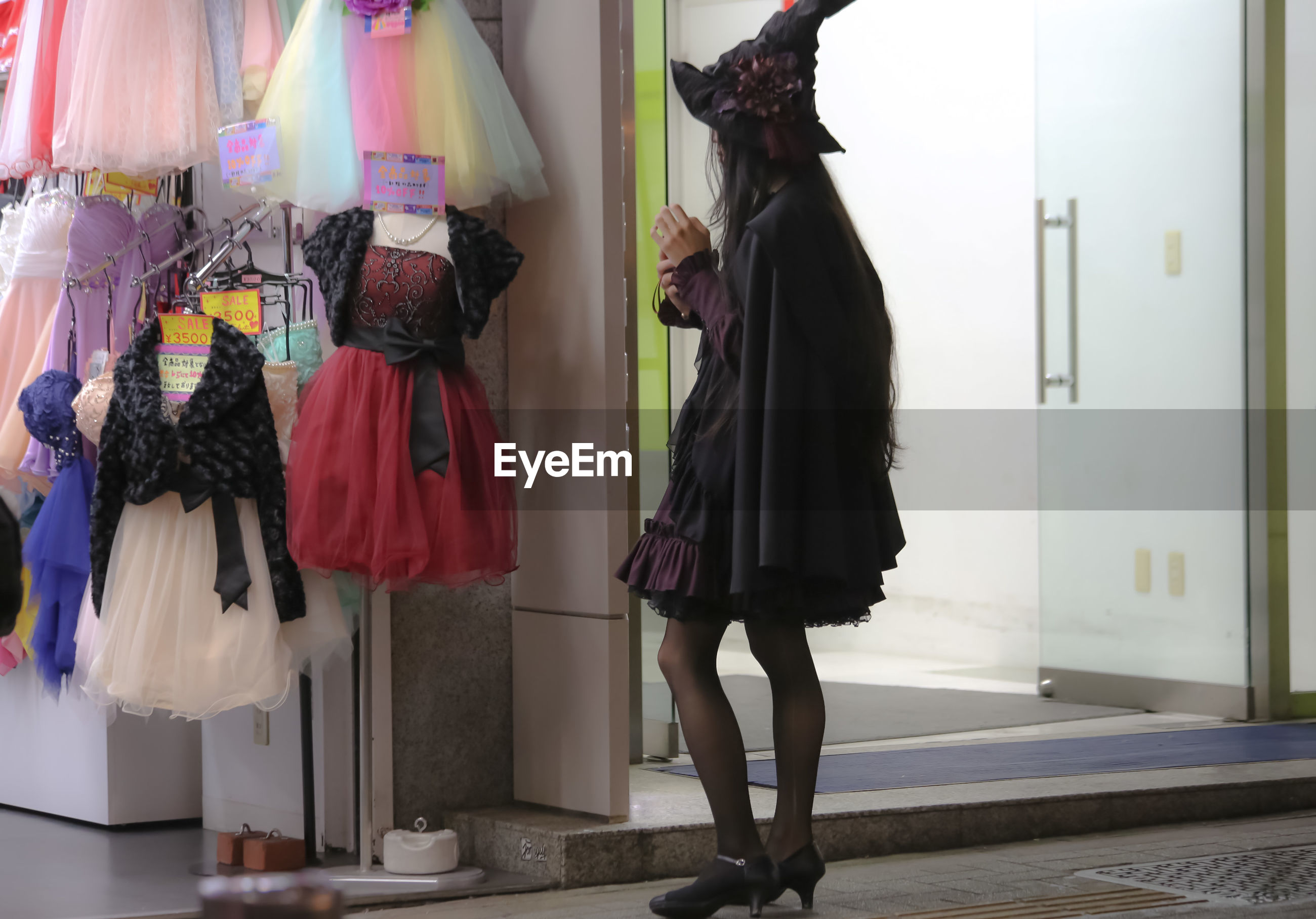 Woman standing by store