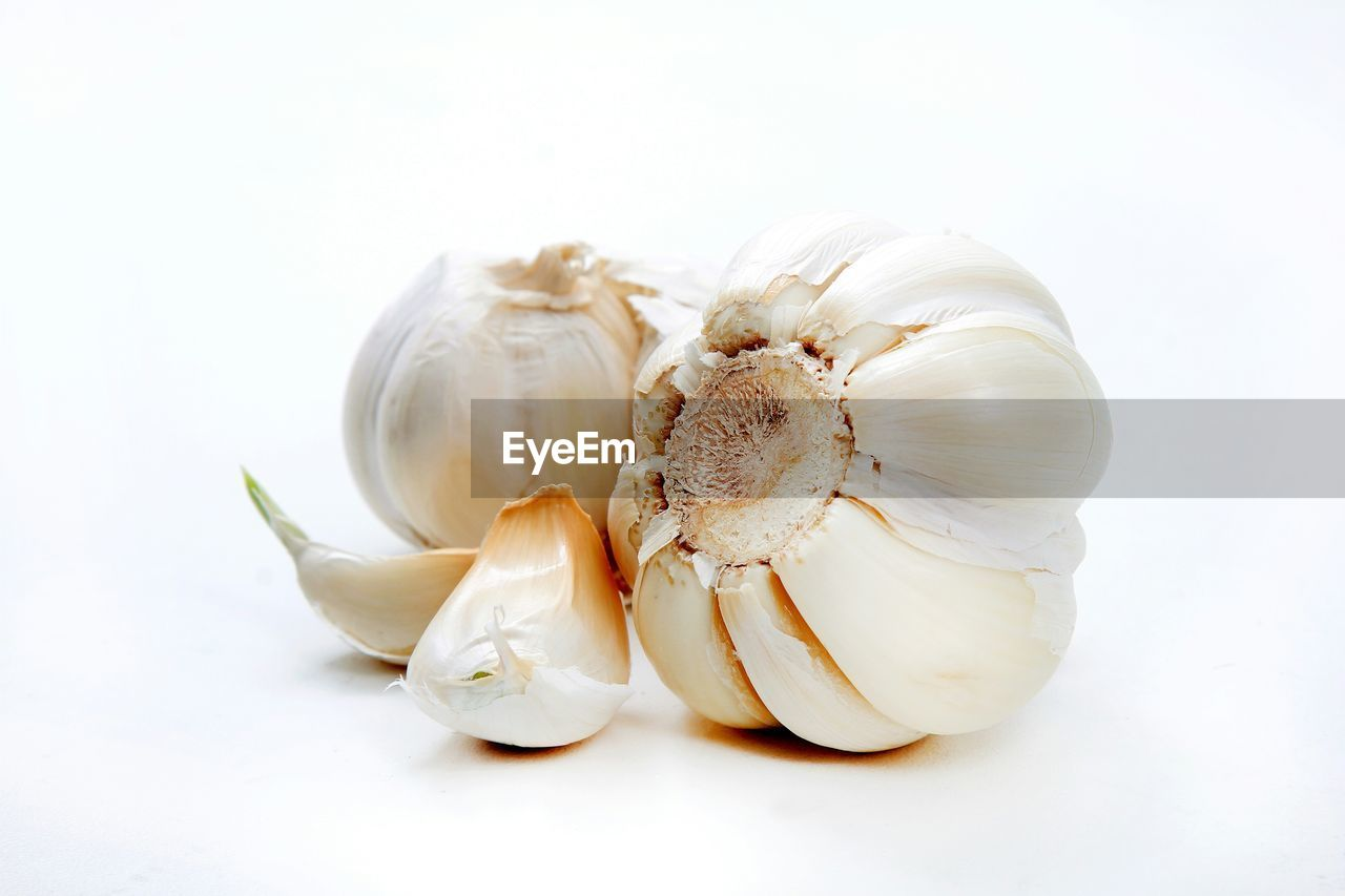 Garlic Bulbs And Cloves On White Background