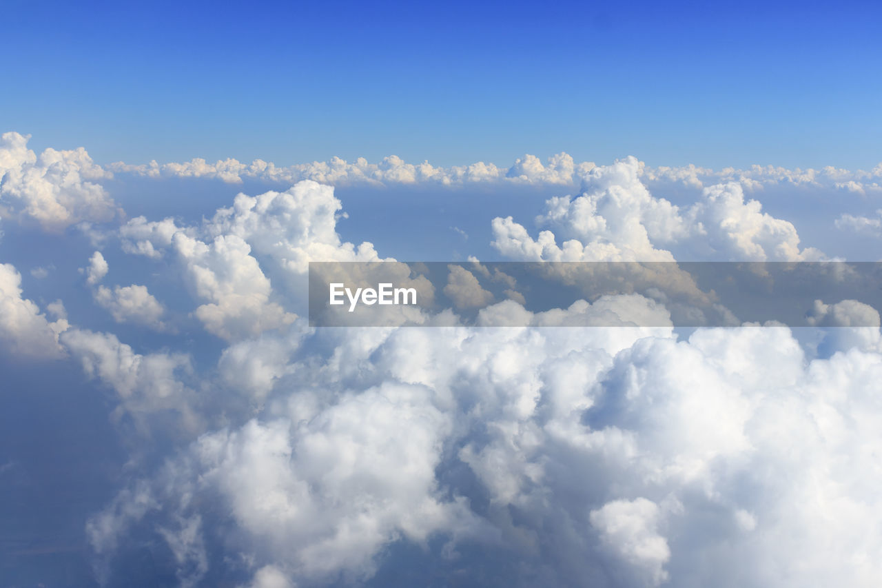 cloud - sky, beauty in nature, sky, scenics - nature, tranquility, blue, low angle view, no people, nature, backgrounds, day, tranquil scene, white color, outdoors, idyllic, full frame, cloudscape, non-urban scene, sunlight, fluffy, meteorology