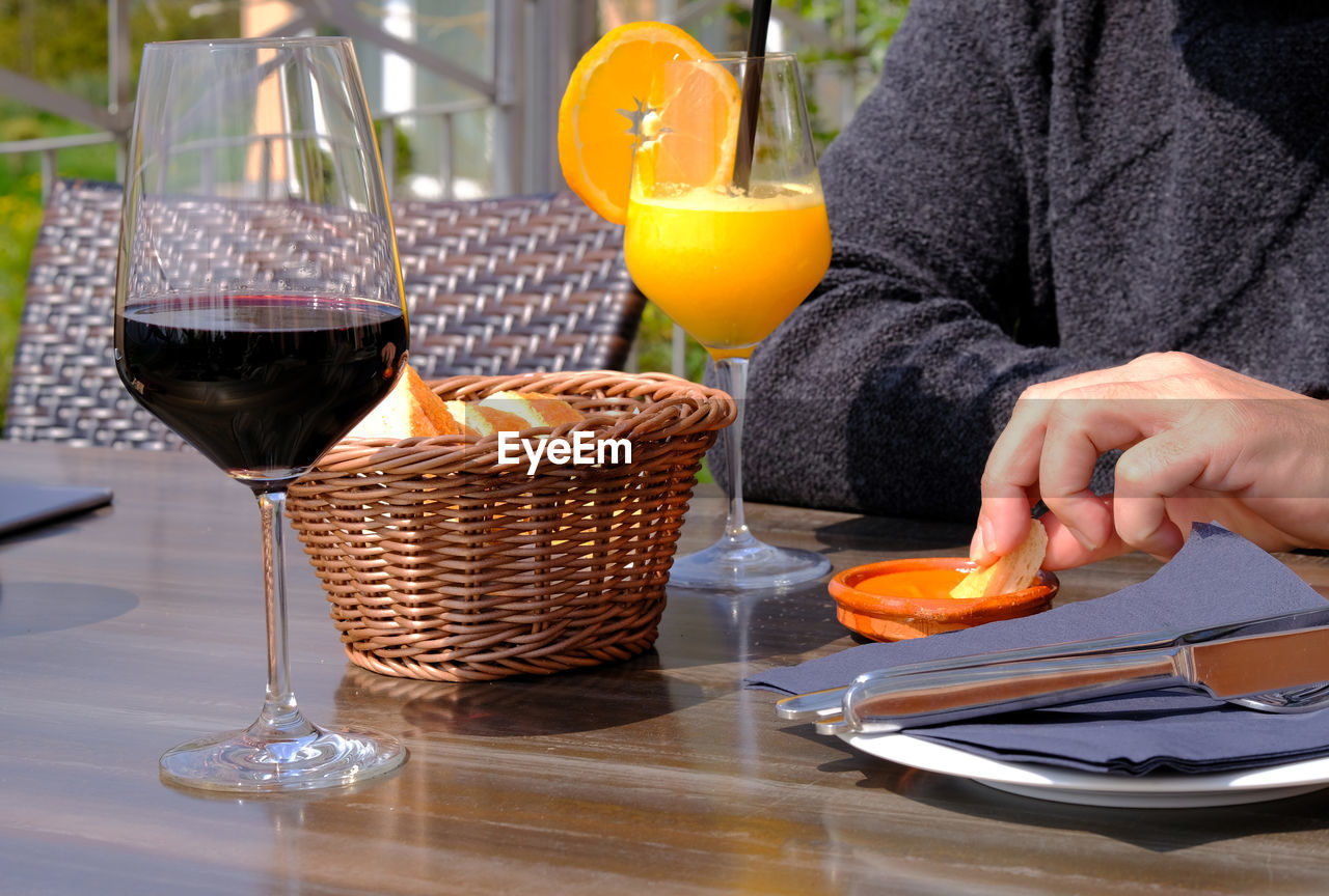 Cropped Image Of Man Having Food And Drink At Table