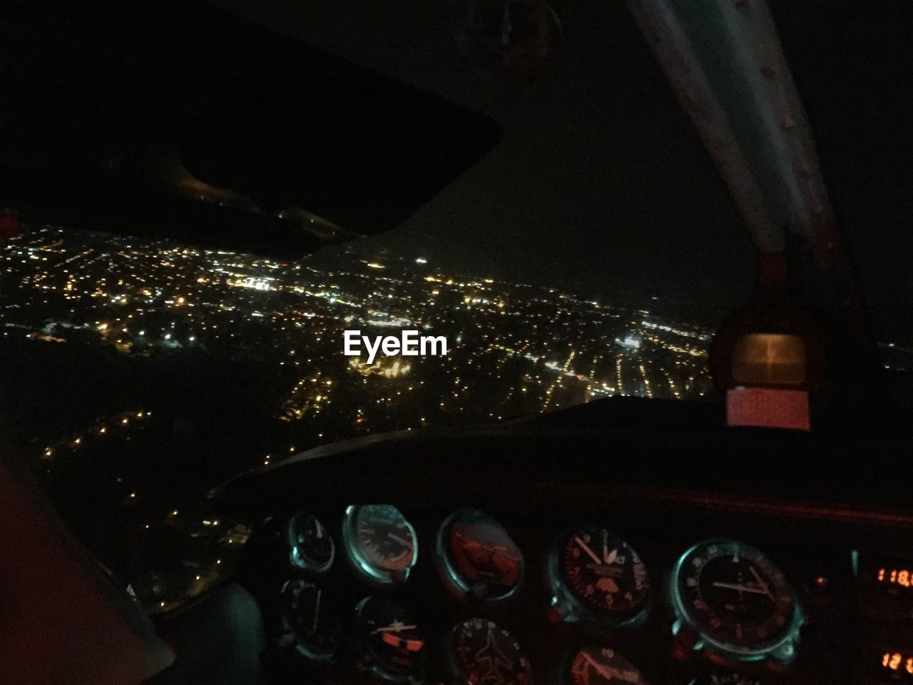 Illuminated residential district seen from airplane window