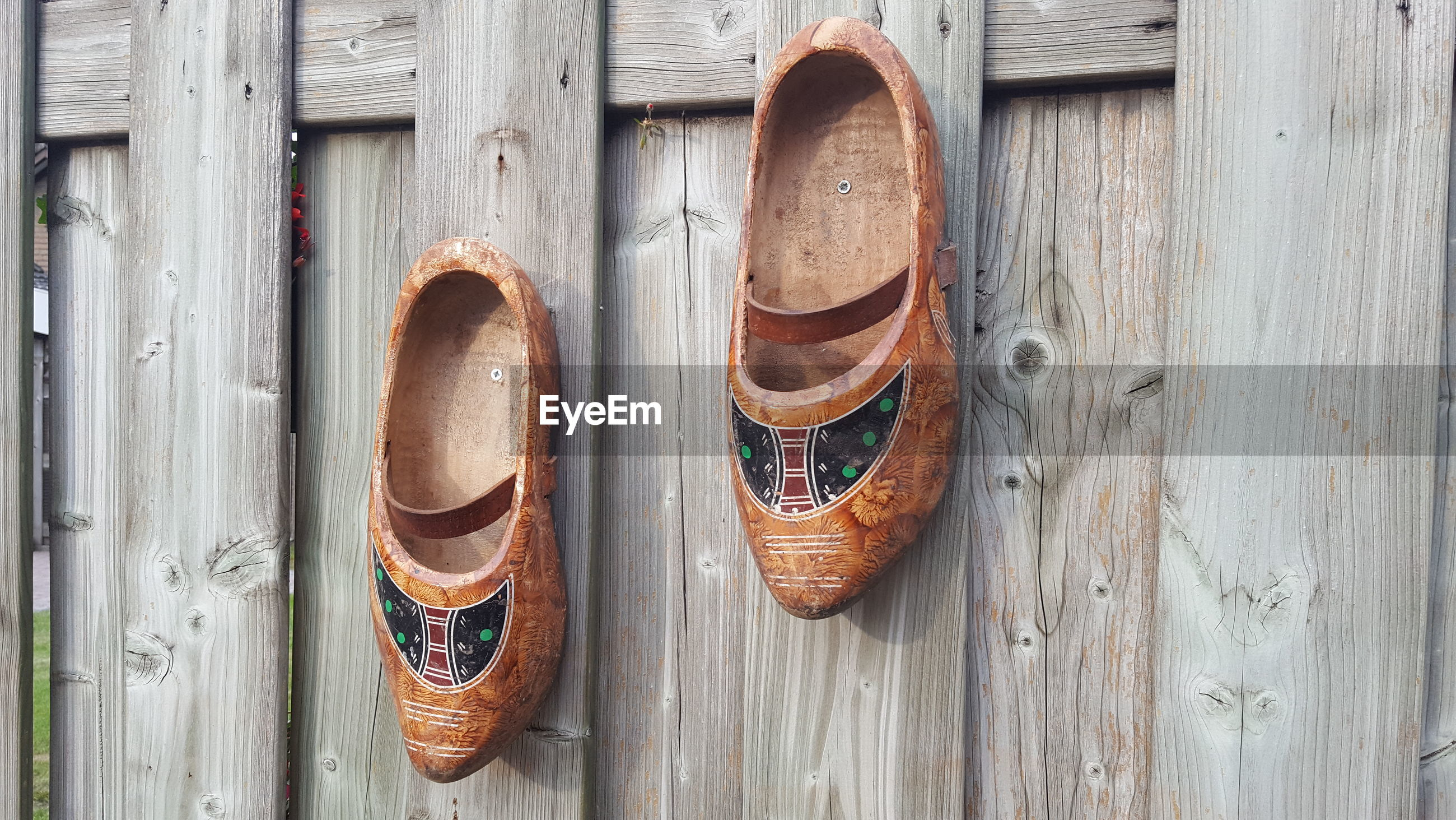 CLOSE-UP OF SHOES ON WOODEN DOOR
