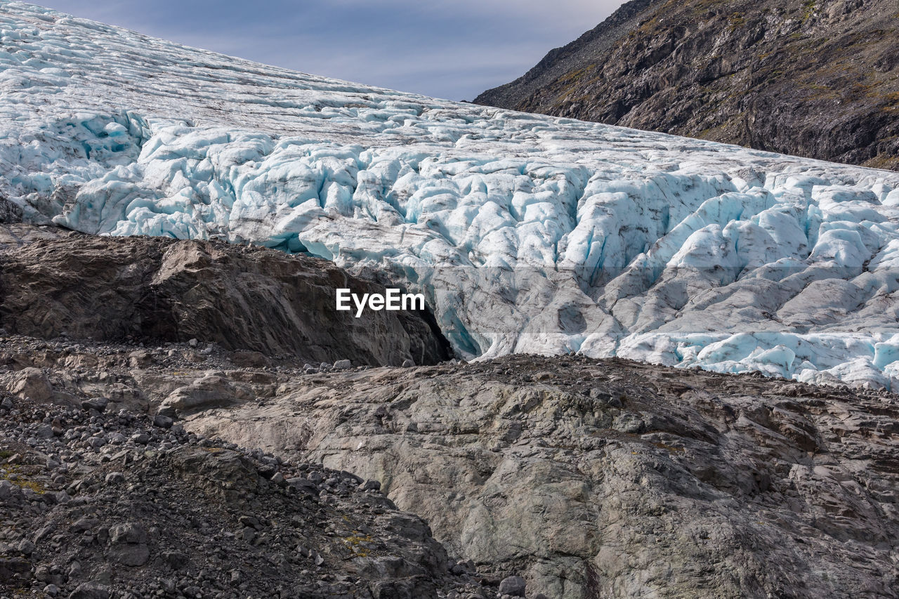 glacier, ice, cold temperature, environment, landscape, winter, scenics - nature, frozen, snow, mountain, nature, sky, no people, tranquility, beauty in nature, rock, day, tranquil scene, water, outdoors, iceberg, cold, melting, formation