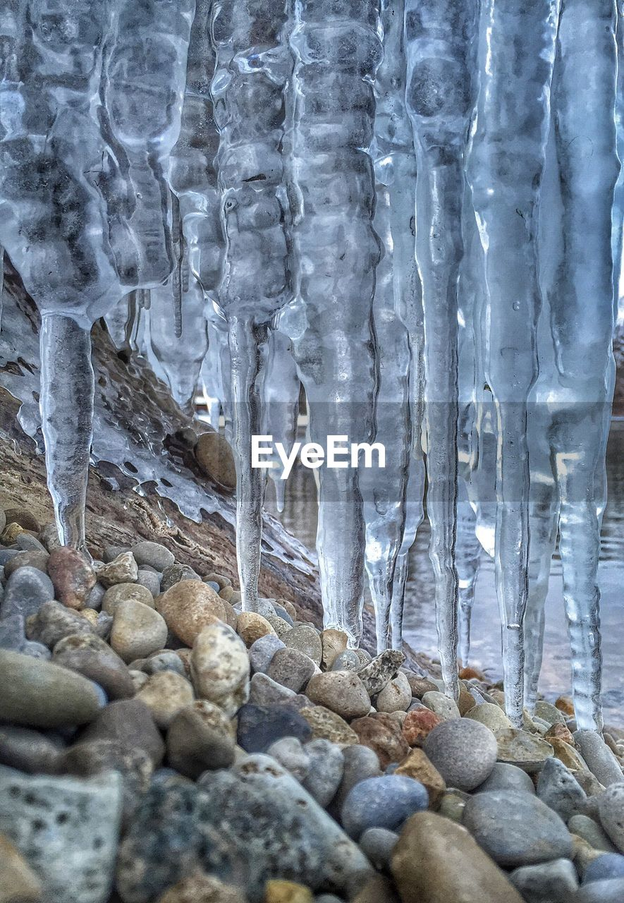 Close-up of icicles and stones