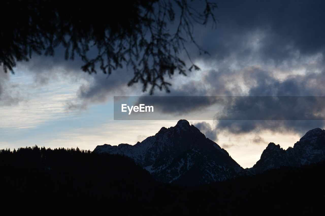 sky, cloud - sky, mountain, beauty in nature, tranquil scene, scenics - nature, tranquility, tree, nature, silhouette, non-urban scene, no people, plant, sunset, mountain range, environment, landscape, idyllic, low angle view, mountain peak, outdoors, snowcapped mountain