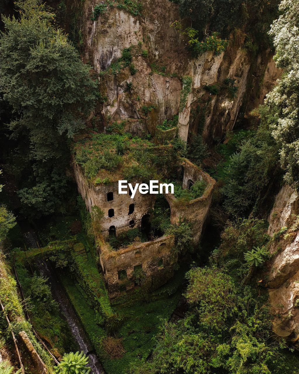 tree, plant, architecture, no people, built structure, day, nature, travel destinations, high angle view, history, the past, land, old, mountain, ancient, foliage, scenics - nature, old ruin, tranquility, outdoors, archaeology, ancient civilization, ruined
