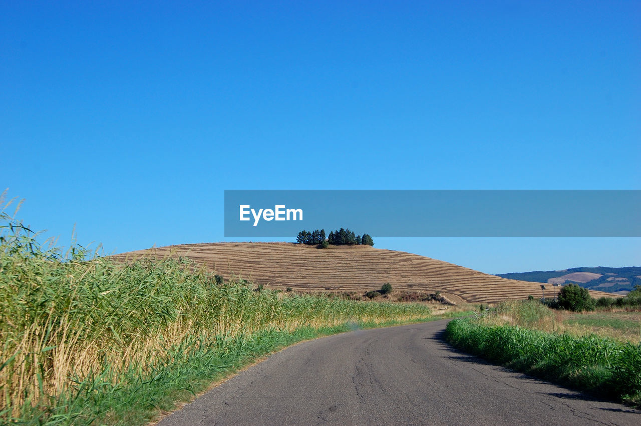 SCENIC VIEW OF ROAD AGAINST CLEAR BLUE SKY