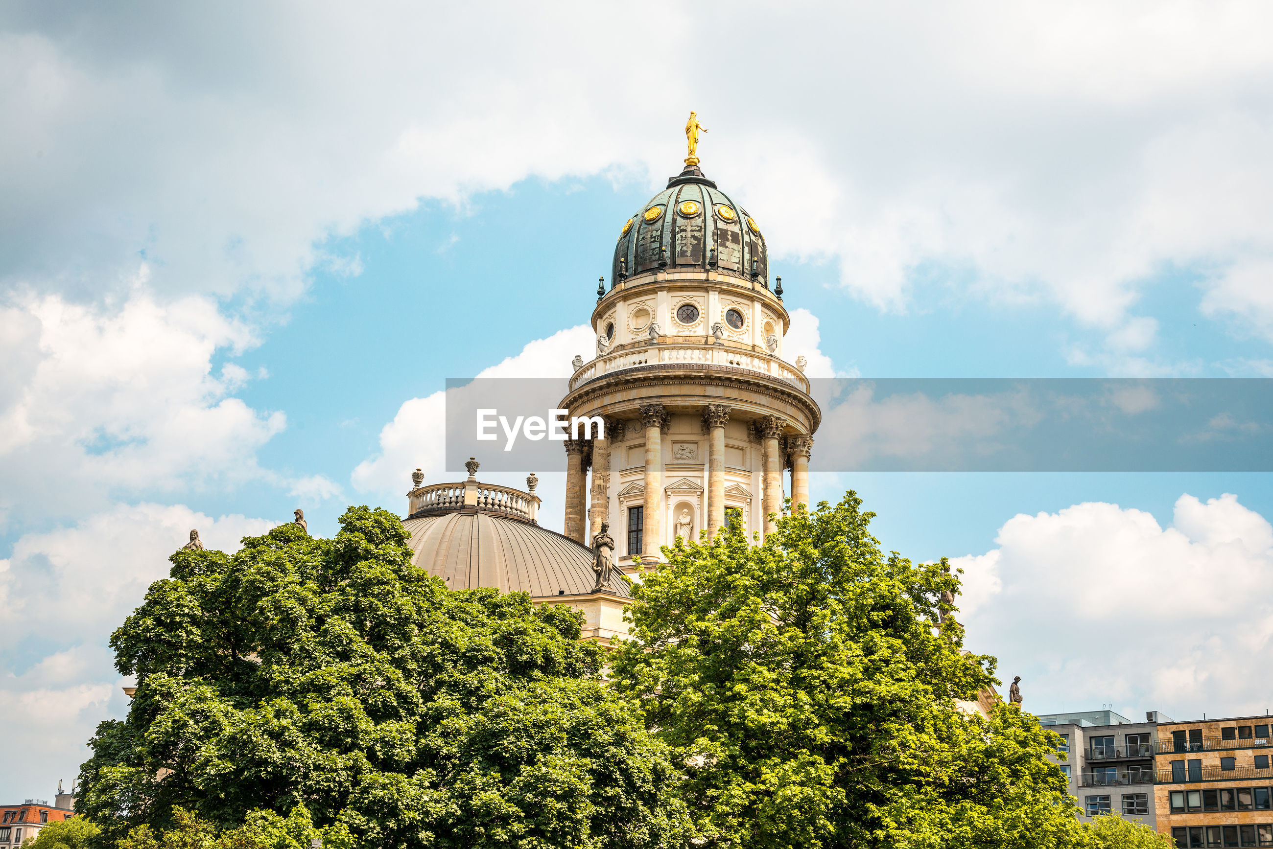 Low angle view of neue kirche against cloudy sky