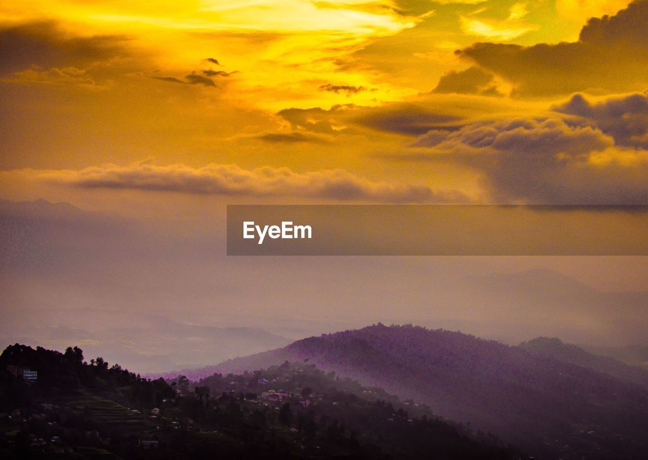 SCENIC VIEW OF LANDSCAPE AGAINST DRAMATIC SKY