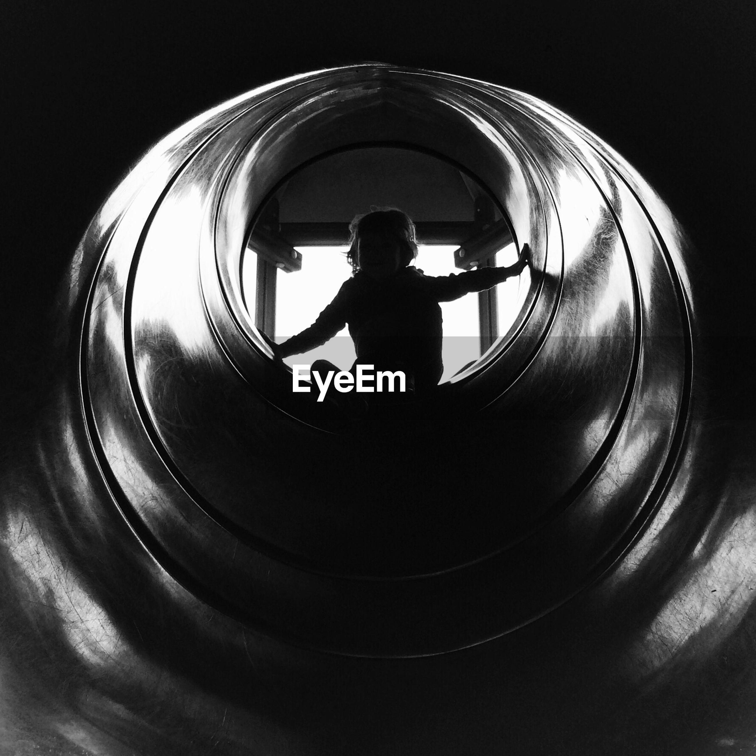 Girl playing in pipe