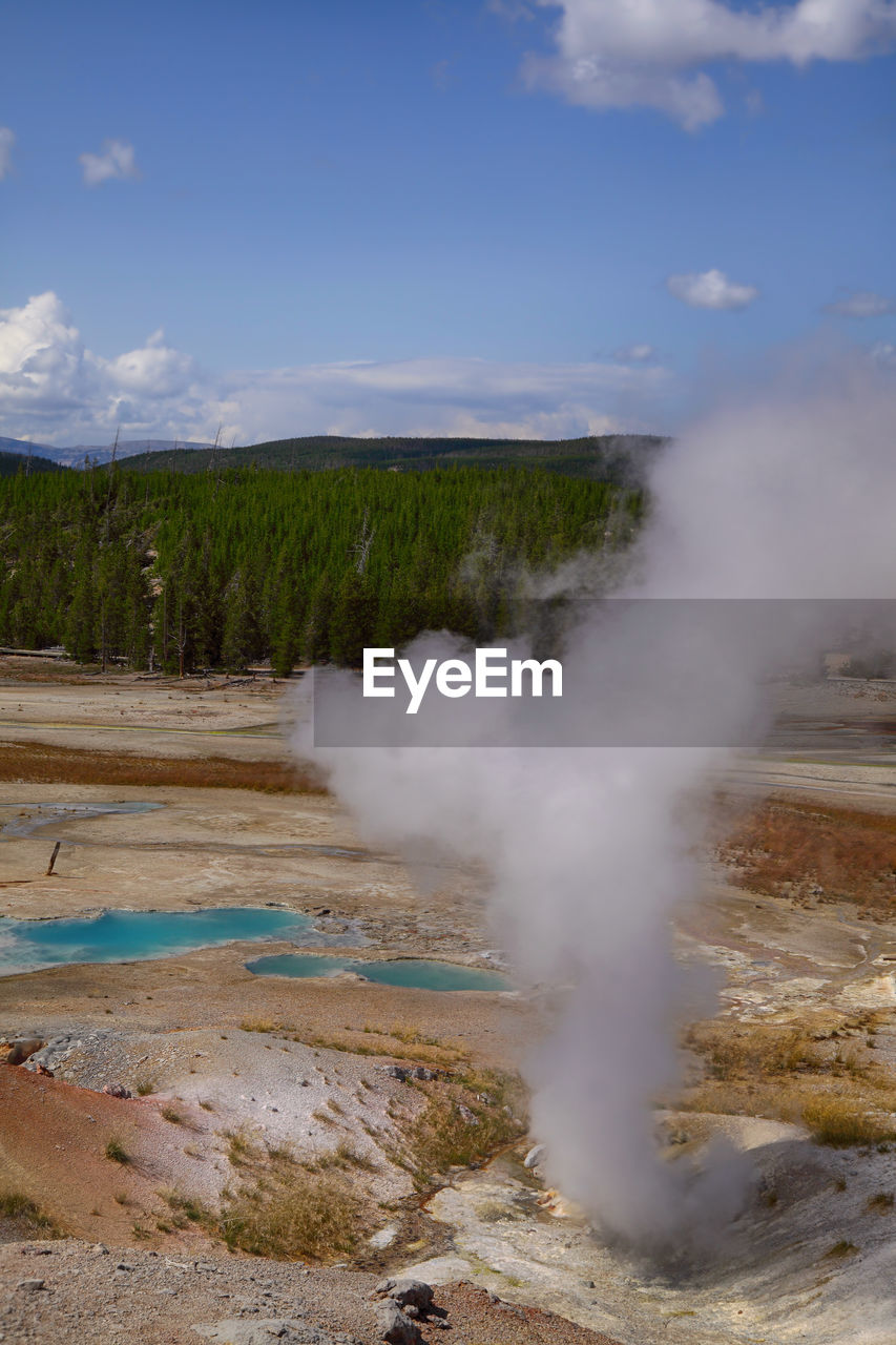 geology, steam, power in nature, geyser, smoke - physical structure, physical geography, hot spring, landscape, beauty in nature, heat - temperature, scenics - nature, non-urban scene, environment, volcanic landscape, volcano, day, water, mountain, erupting, nature, no people, outdoors, volcanic crater