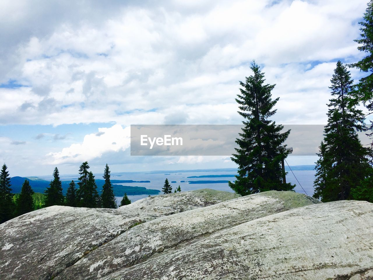 cloud - sky, sky, nature, rock - object, tranquility, tree, tranquil scene, scenics, day, outdoors, beauty in nature, no people, mountain, growth, water