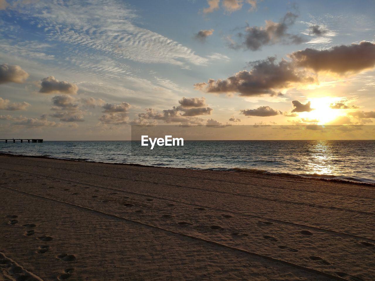 sky, sunset, sea, water, land, beach, scenics - nature, cloud - sky, beauty in nature, horizon over water, horizon, tranquil scene, tranquility, nature, idyllic, sand, non-urban scene, outdoors, no people