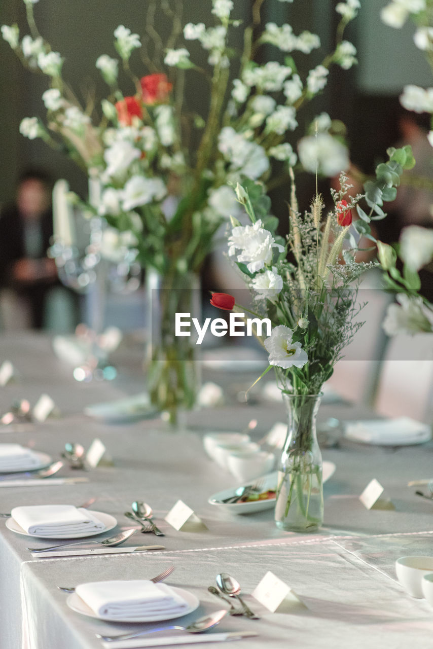 plant, table, focus on foreground, flower, flowering plant, no people, nature, vase, celebration, close-up, day, freshness, indoors, arrangement, decoration, flower arrangement, plate, beauty in nature, place setting, glass, setting, flower head, bouquet
