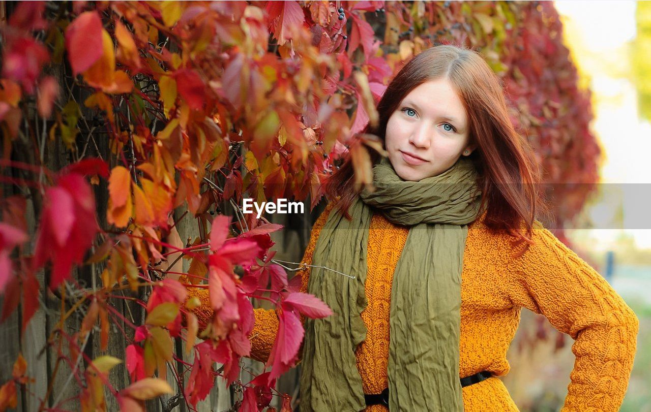autumn, beautiful woman, long hair, young adult, young women, leaf, one person, looking at camera, portrait, real people, tree, nature, outdoors, red, scarf, front view, day, one young woman only, headshot, smiling, beauty, only women, park - man made space, leisure activity, growth, beauty in nature, standing, plant, adult, lifestyles, one woman only, adults only, women, close-up, people