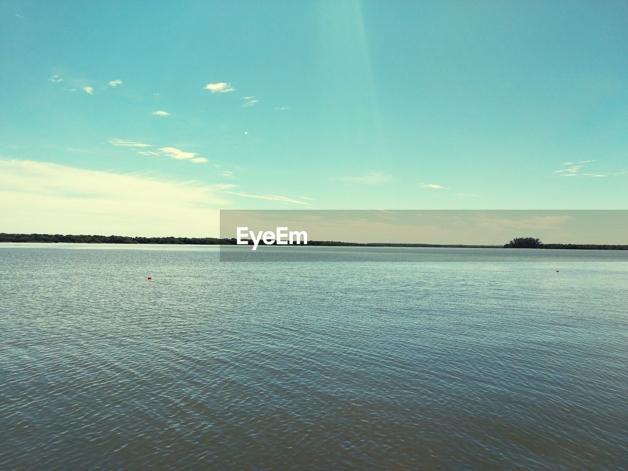 scenics, tranquil scene, sky, sea, tranquility, water, beauty in nature, nature, rippled, idyllic, waterfront, outdoors, blue, no people, cloud - sky, day, landscape, horizon over water, view into land