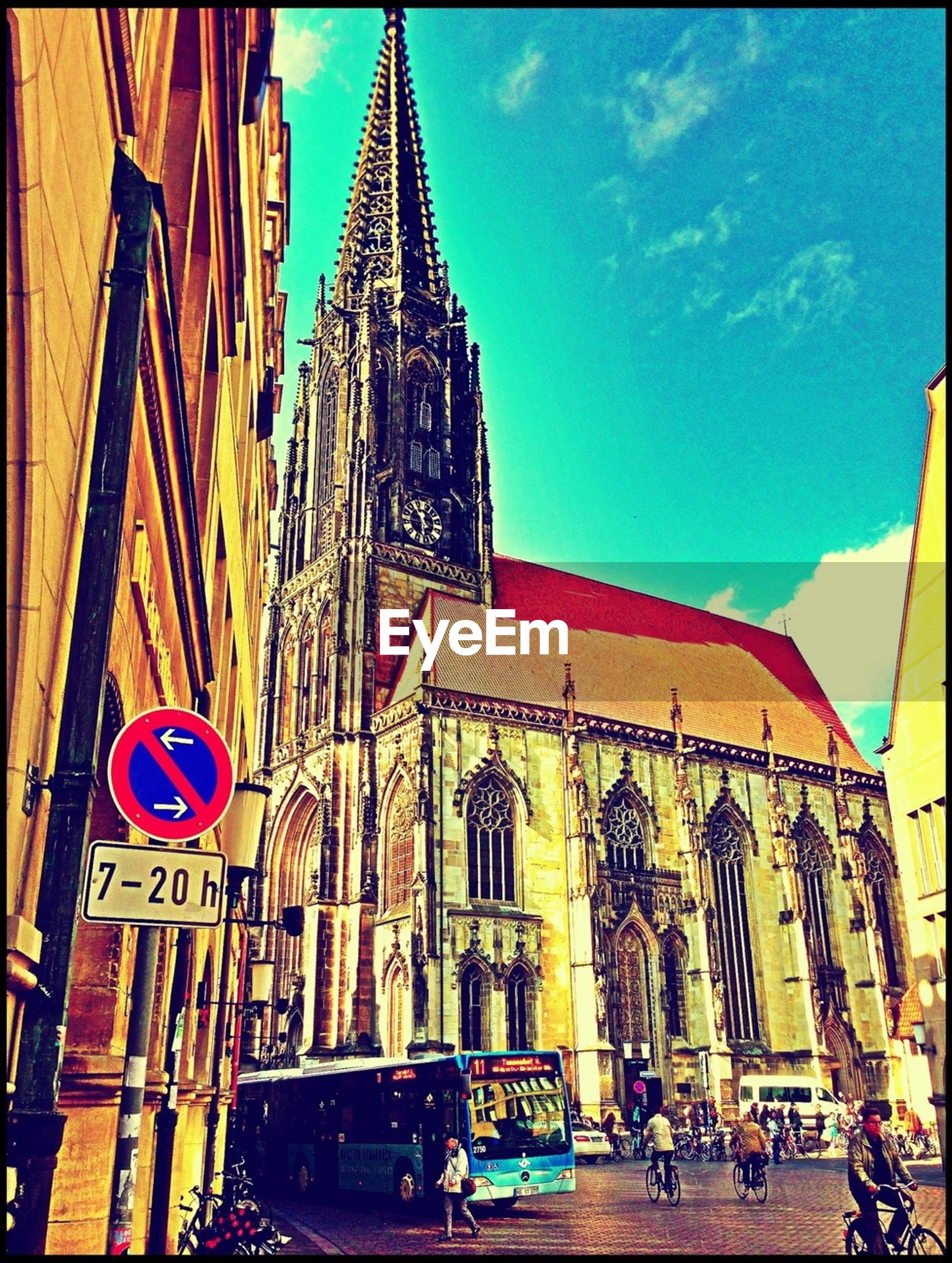 architecture, building exterior, built structure, city, low angle view, street, sky, church, incidental people, car, place of worship, transportation, religion, travel destinations, travel, famous place, land vehicle, city life, facade