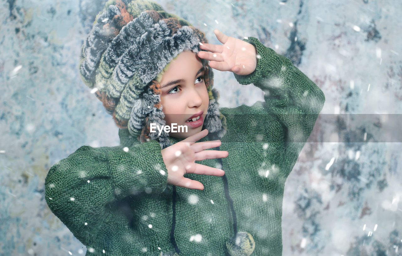 Close-Up Cute Girl Standing Outdoors During Snowing