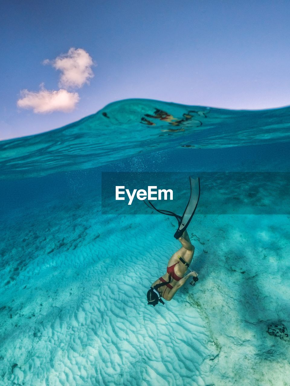 sea, water, nature, sky, underwater, one person, blue, swimming, full length, undersea, beauty in nature, day, leisure activity, adventure, real people, exploration, turquoise colored, trip, snorkeling