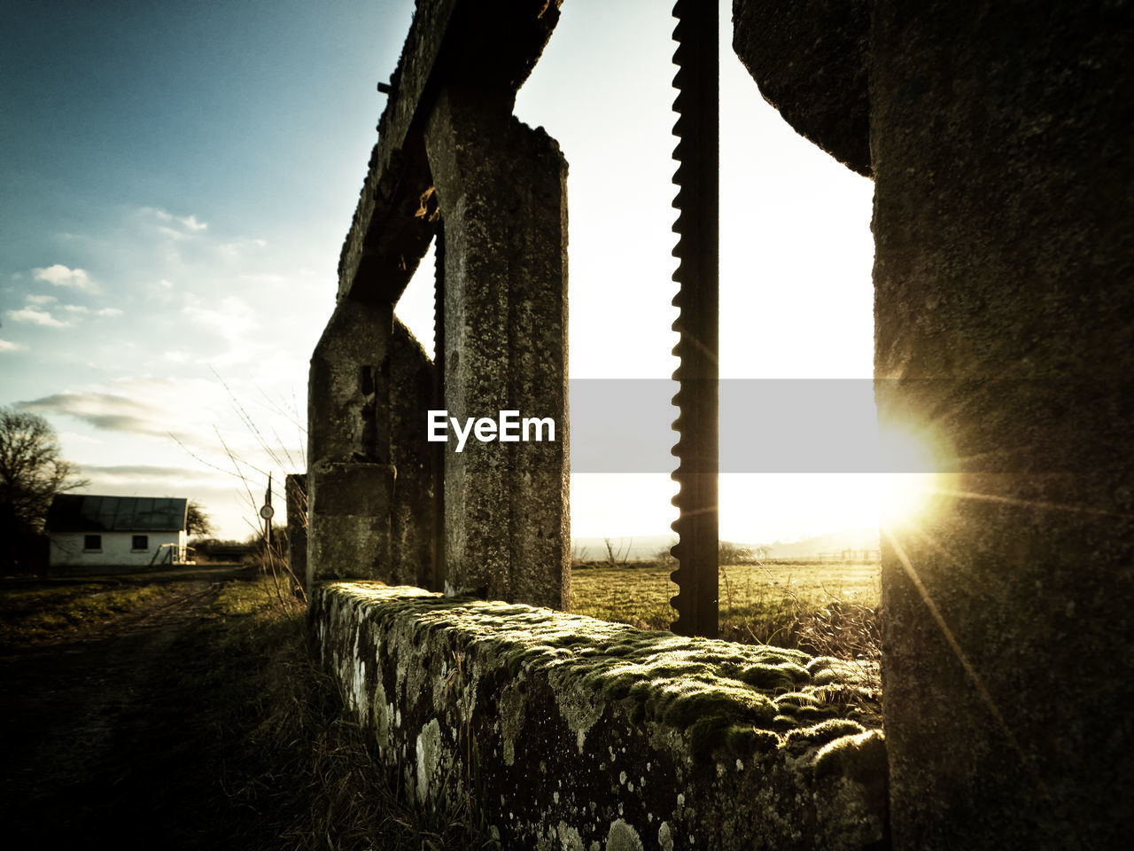 sunlight, sun, sunbeam, lens flare, architecture, sky, built structure, no people, field, building exterior, outdoors, day, old ruin, sunset, grass, nature, tree