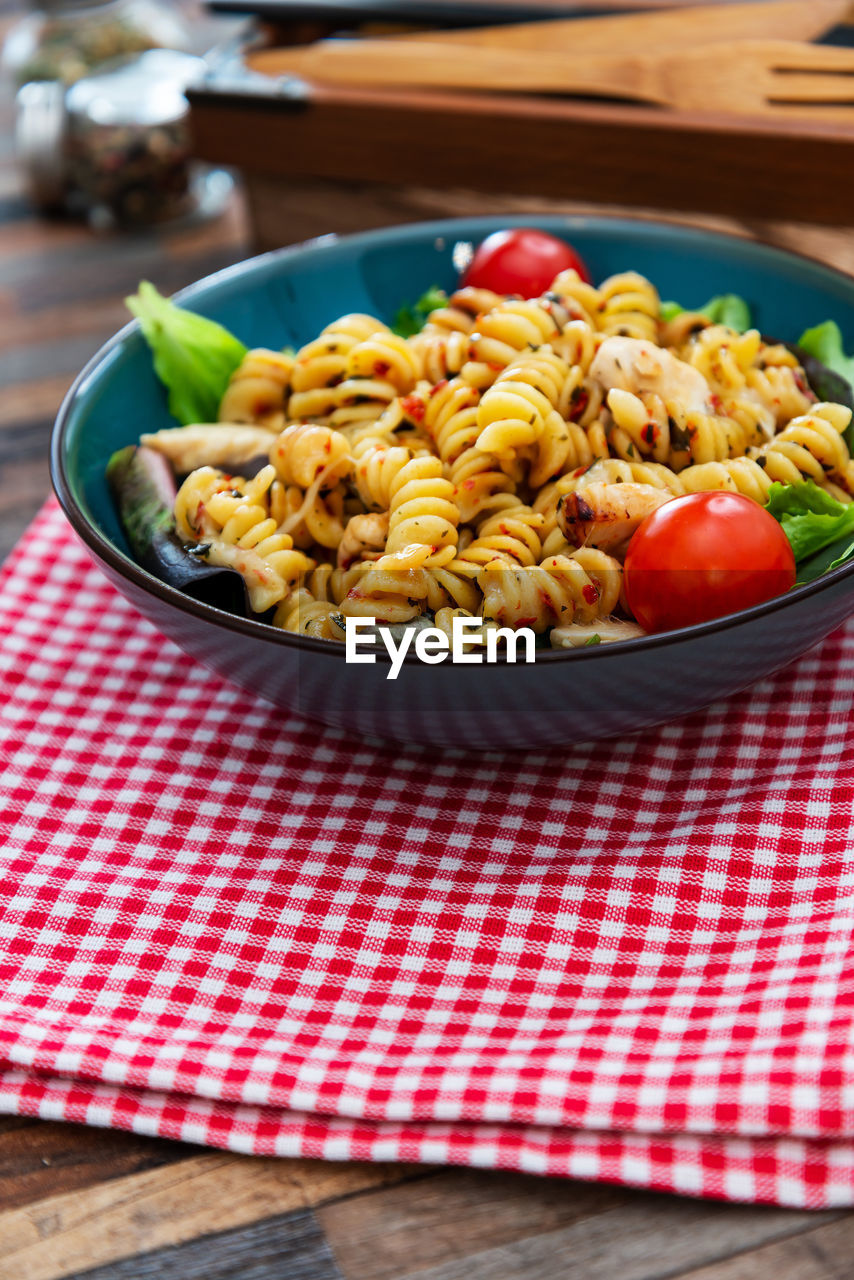 food and drink, food, table, pasta, wellbeing, fruit, freshness, healthy eating, vegetable, red, no people, indoors, checked pattern, ready-to-eat, italian food, close-up, tomato, focus on foreground, still life, tablecloth, tray, snack