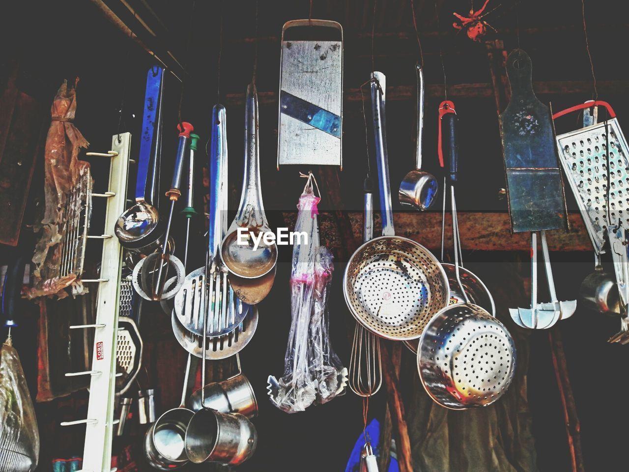Kitchen utensils hanging for sale at market