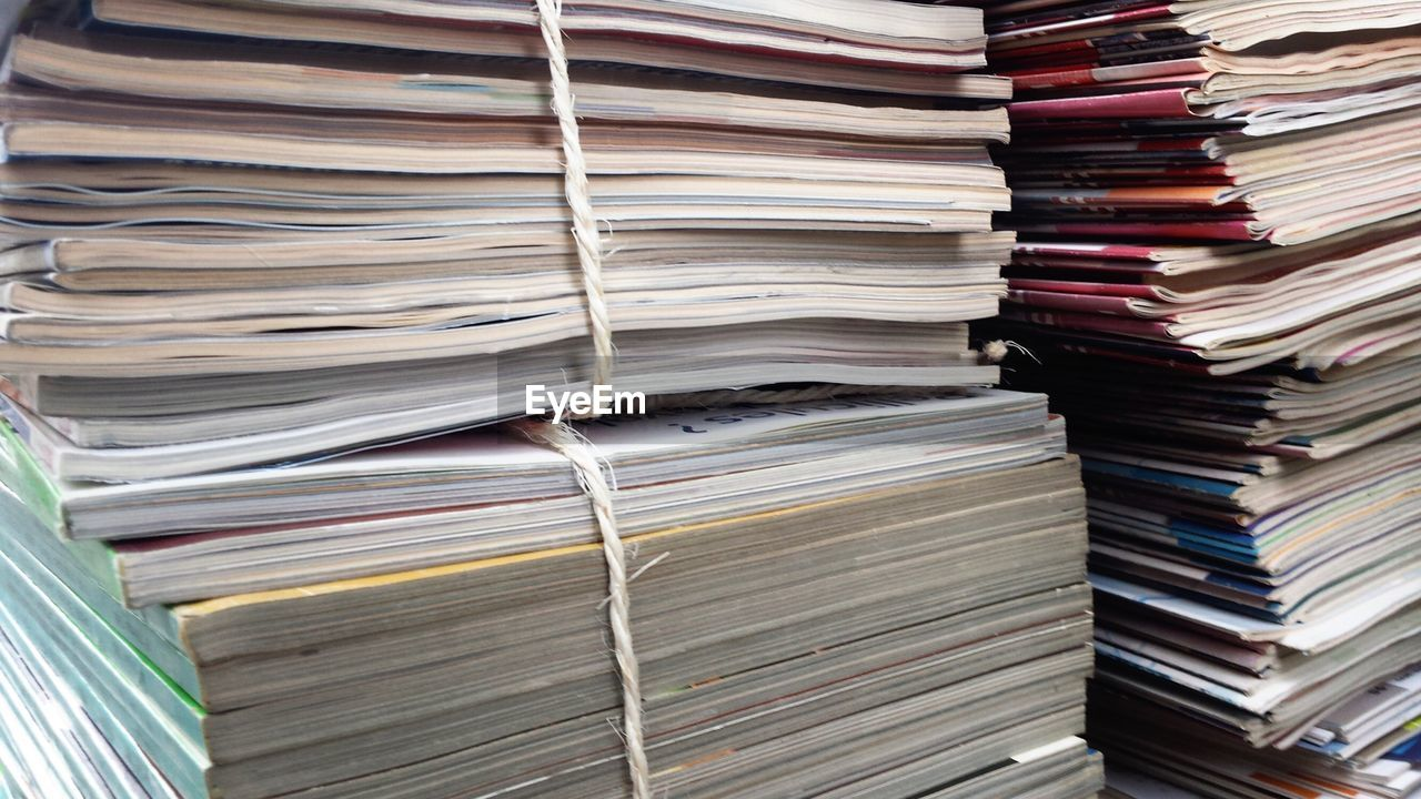 Close-up of stack of magazines
