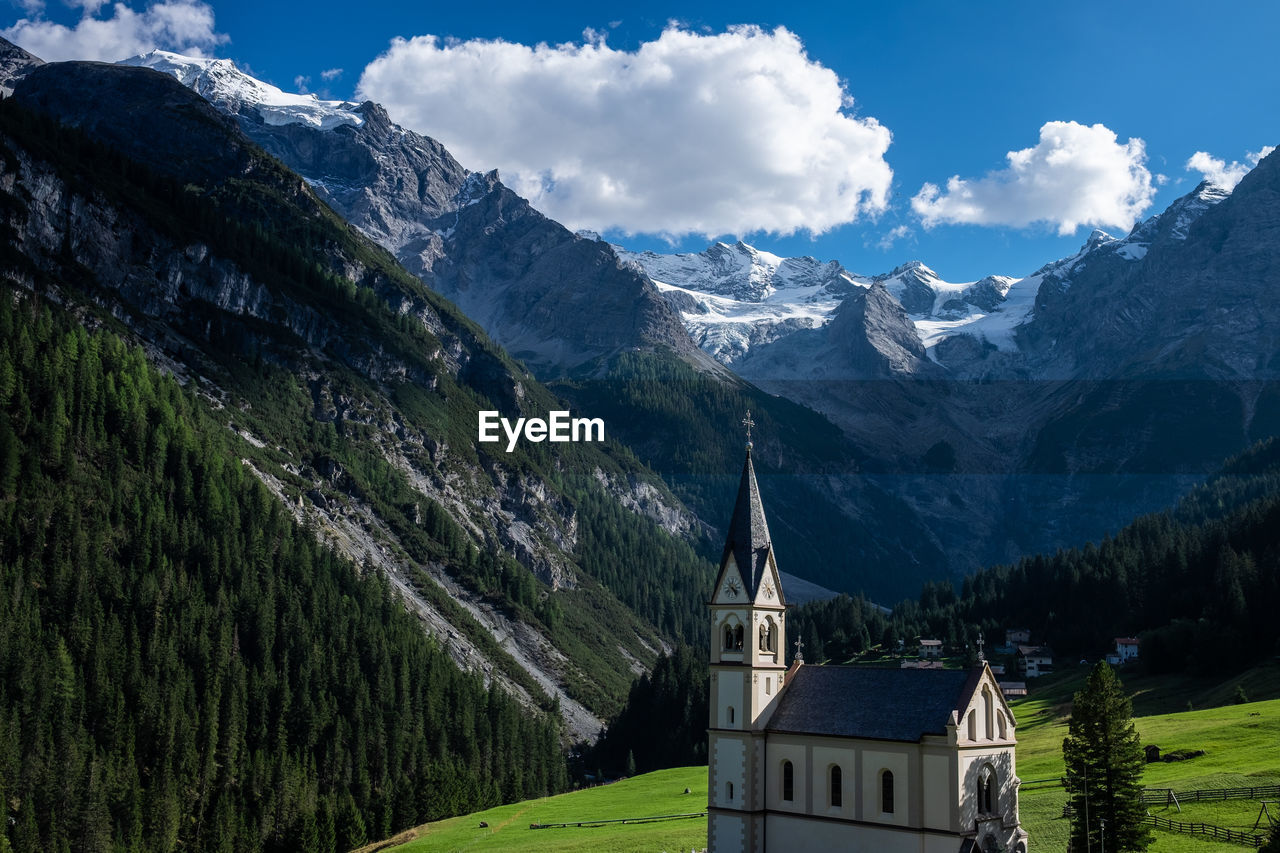 High Angle View Of Church By Mountains Against Sky