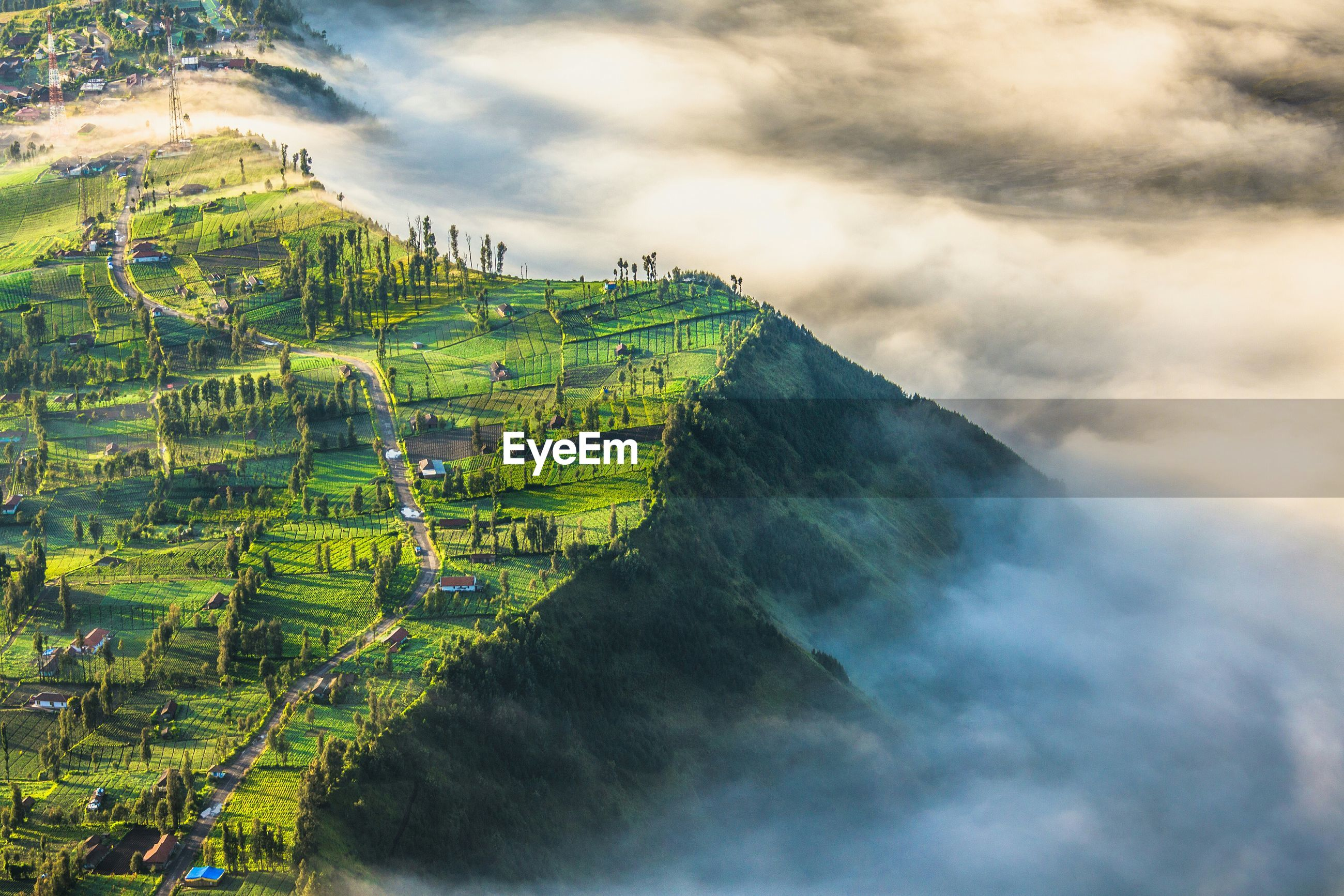 High angle view of mountain peak with foggy weather