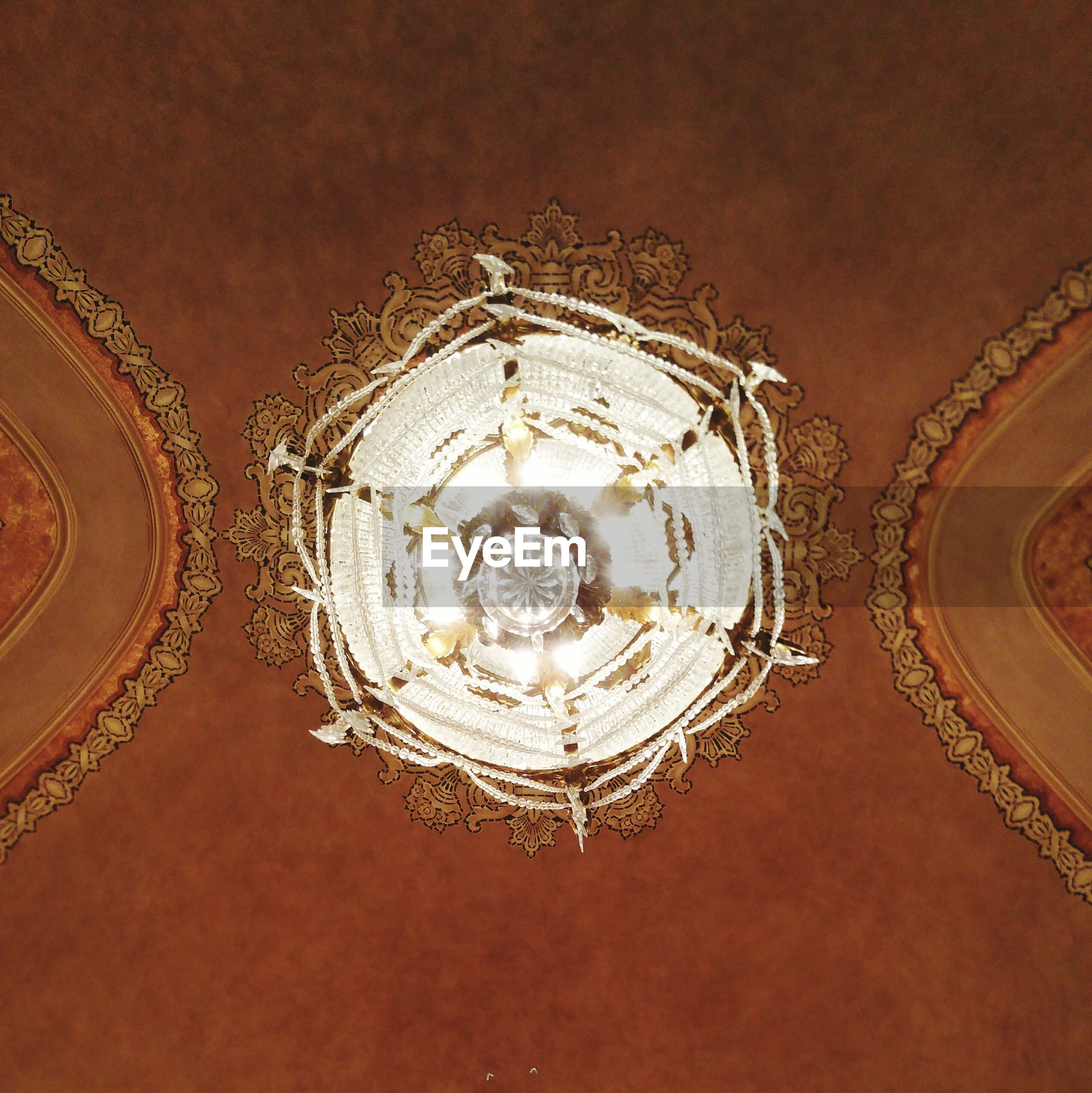 LOW ANGLE VIEW OF ORNATE CHANDELIER
