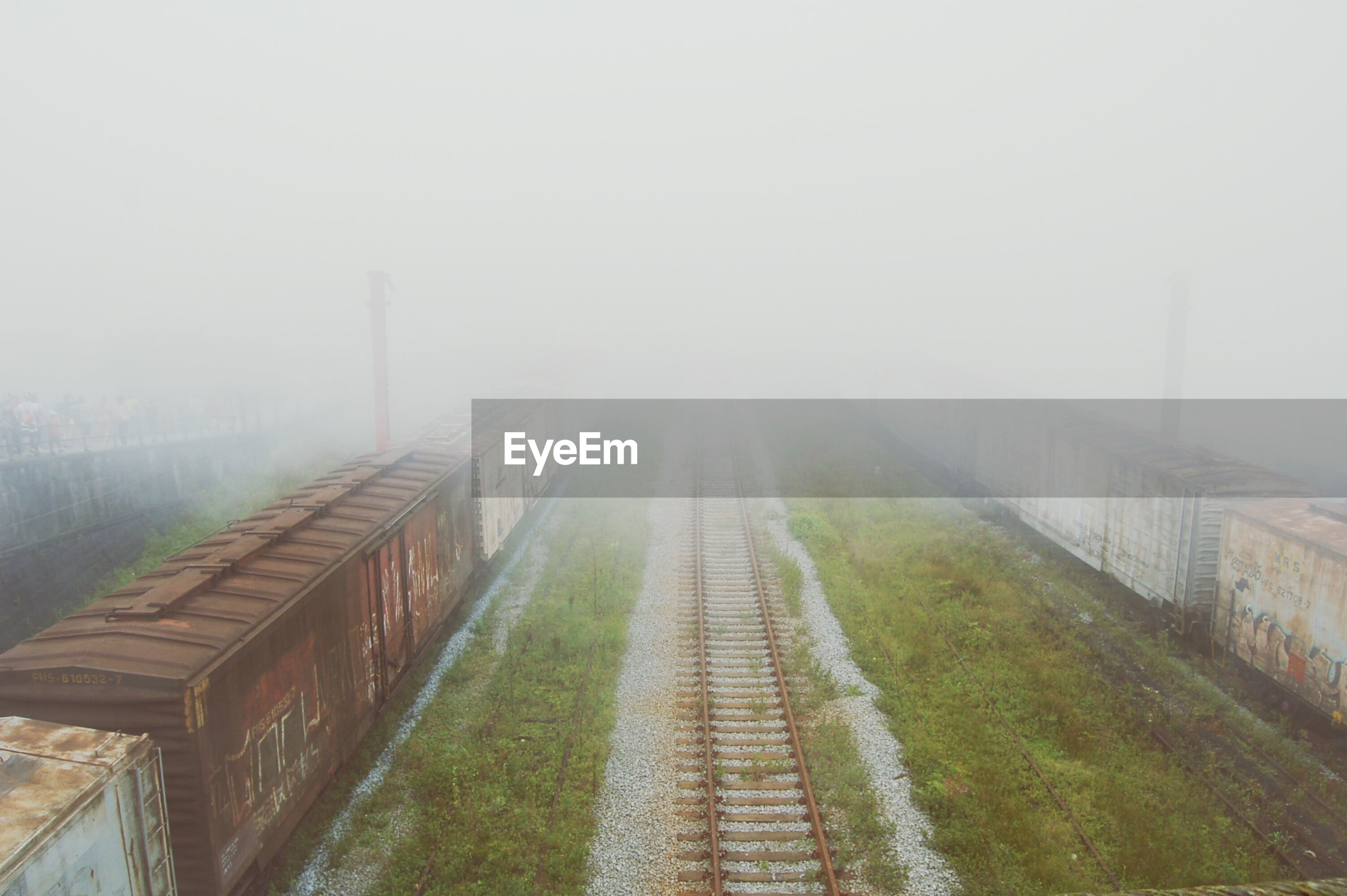 the way forward, fog, diminishing perspective, foggy, vanishing point, weather, built structure, copy space, architecture, sky, transportation, tranquility, day, nature, outdoors, no people, long, tranquil scene, railroad track