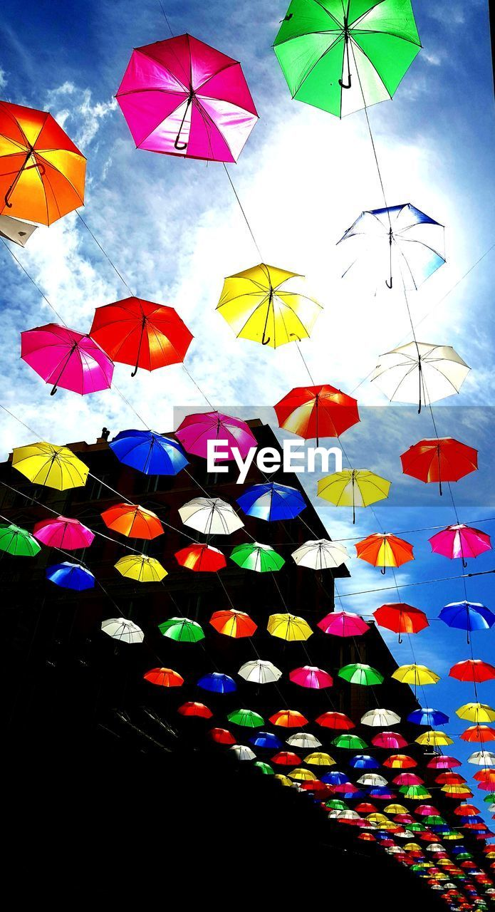 multi colored, protection, umbrella, low angle view, security, decoration, hanging, no people, sky, variation, creativity, large group of objects, choice, safety, nature, cloud - sky, day, outdoors, pattern