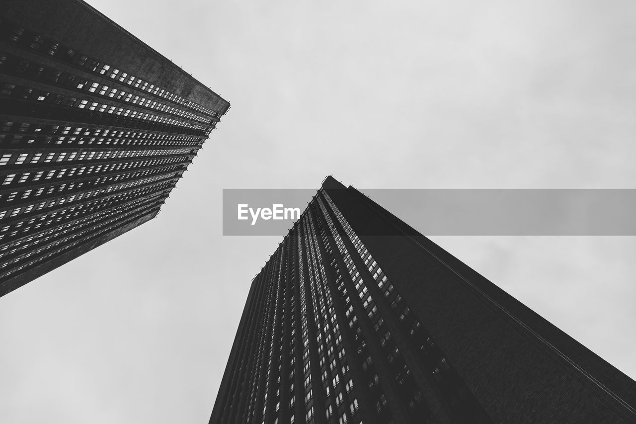 built structure, architecture, building exterior, sky, low angle view, office building exterior, building, modern, office, city, tall - high, skyscraper, no people, nature, tower, day, outdoors, cloud - sky, pattern, financial district