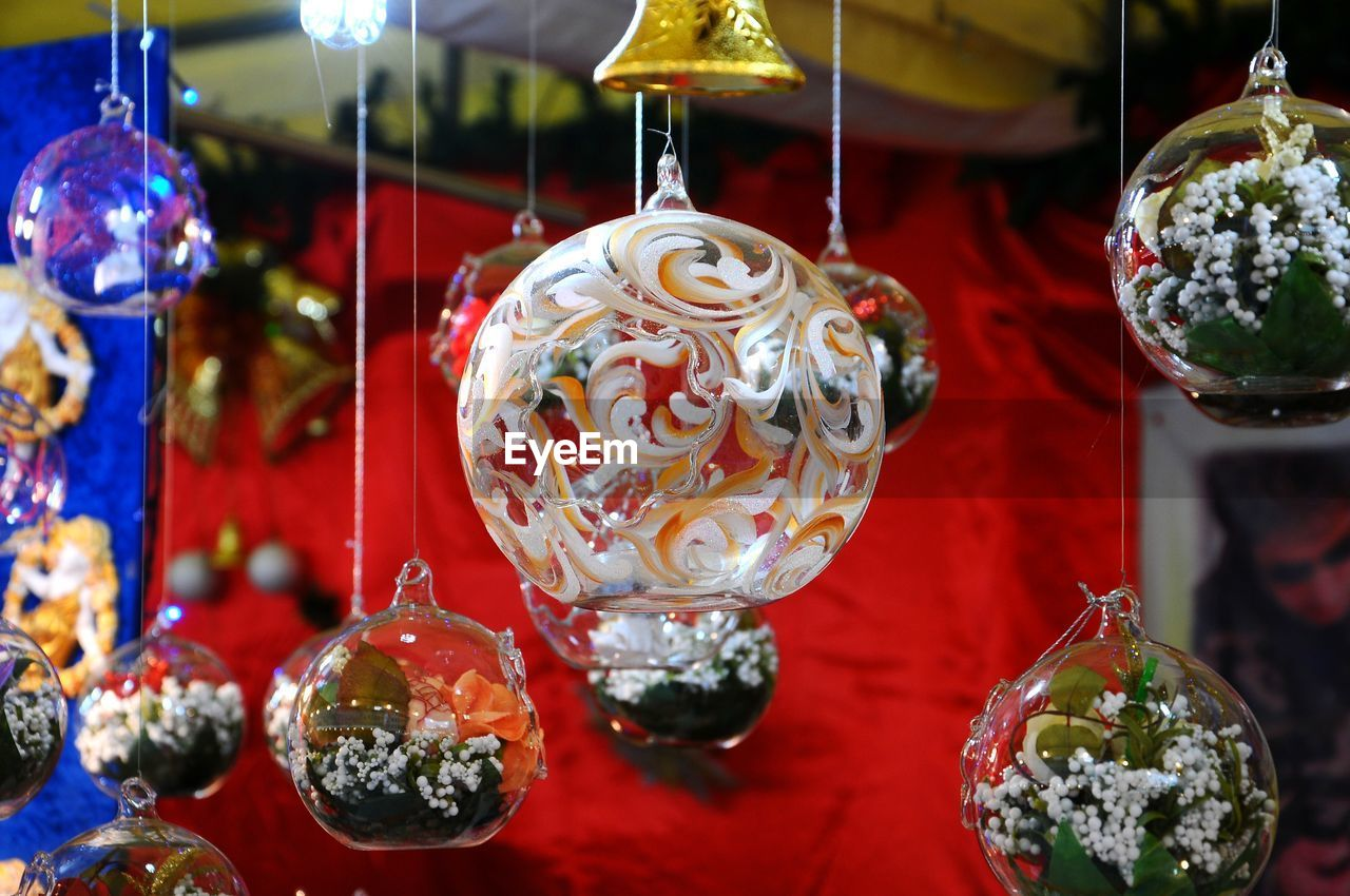 Close-up of christmas decorations hanging at market stall