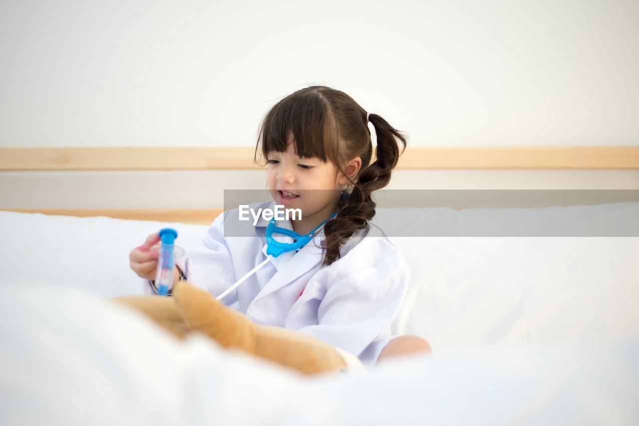 PORTRAIT OF CUTE GIRL IN BED