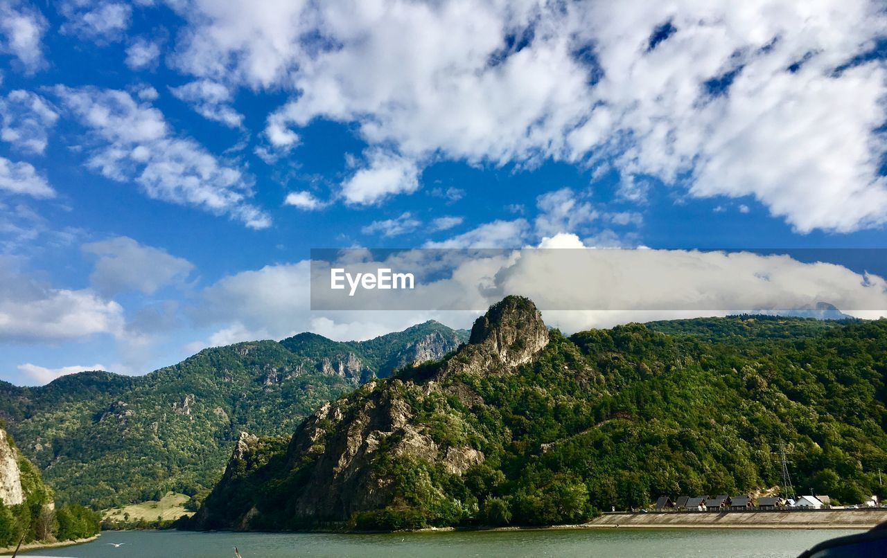 cloud - sky, sky, mountain, scenics - nature, beauty in nature, tranquil scene, water, tranquility, nature, day, no people, mountain range, tree, non-urban scene, idyllic, travel, plant, waterfront, outdoors, formation