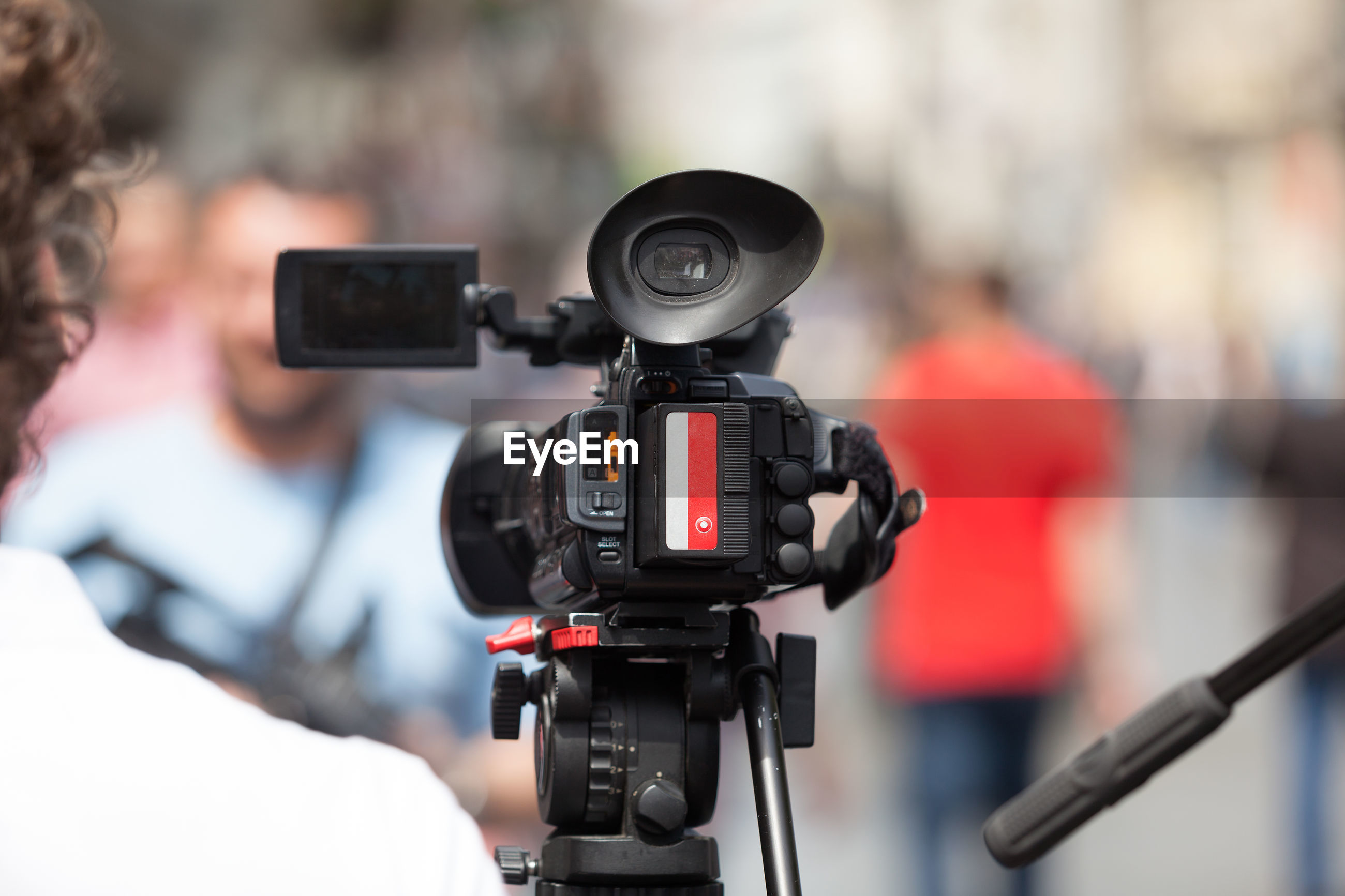 Close-up of video camera during press conference
